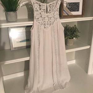 White swing dress with lace detail